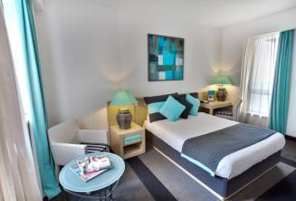 Sypialnia w hotelu Juliani w St Julians, Malta